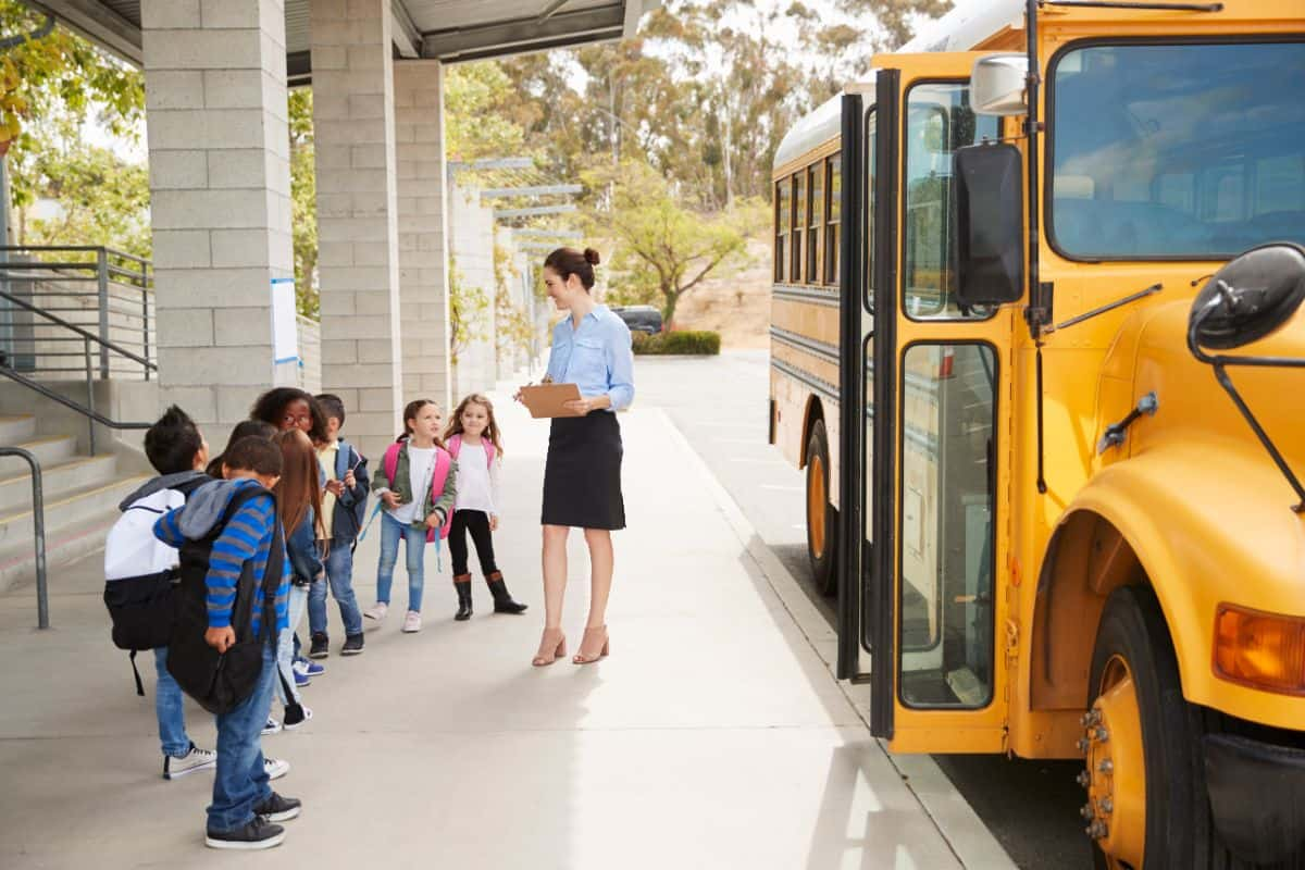 School bus with kids in front