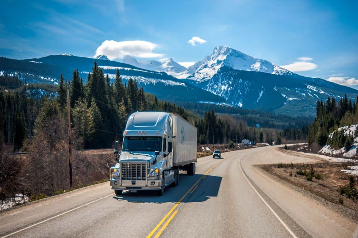 semi-truck with mountain behind